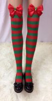 Striped Stockings With Red Bows and Christmas Tree