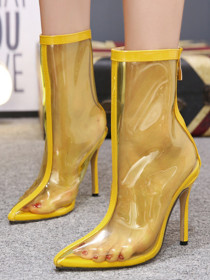 Transparent high-heeled boots with pointed tips
