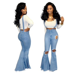 Fashionable wide-legged, knee-pierced jeans with microbell straps