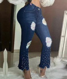 Elastic flared pants with pearl decoration