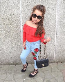 Red blouse + Rose, light blue jeans