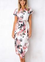 Longue robe florale irrégulière à manches courtes