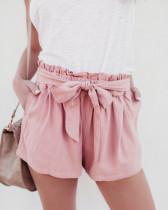 Corto rosa precioso con volantes en la cintura