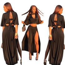 Zwarte cut-out top en high-cut maxi rok