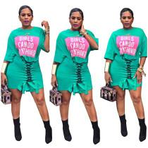 Vestido camisero verde con cordones estampado