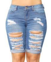Shorts desgastados de Jean azul desgarrado