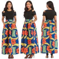 Top de manga corta negro y falda maxi estampada africana