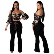 Strapless kettingen Print Top en zwarte broek