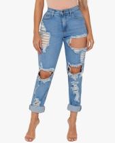 Lavado de pantalones vaqueros dañados azul