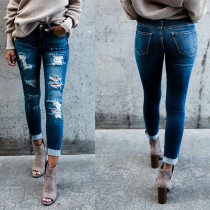 Washing Out Blue Ripped Jeans