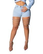 Jeans cortos desgastados azules que se lavan