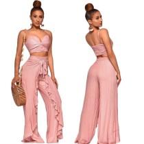 Pantacourt à bretelles roses et pantalon à volants