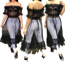 Schulterfreies schwarzes Netzkleid mit Rüschen