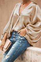 Blusa lisa con cuello en V y manga corta con ajuste holgado