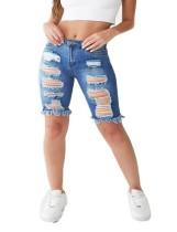 Rits blauwe gescheurde spijkerbroek