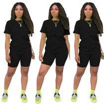 Doorschijnend shirt met O-hals en strakke shorts