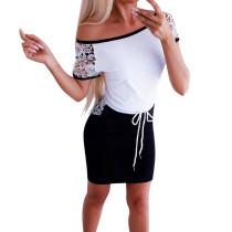 Mini abito a contrasto con coulisse sulle spalle