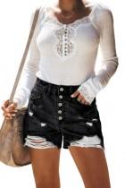 Pantalones cortos de mezclilla rasgados de cintura alta negros