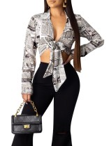 Newsletter Print Knot Long Sleeve Crop Top