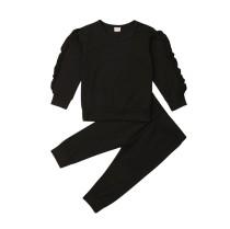 Set camicia e pantaloni per bambina in tinta unita con volant