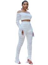 Top corto y pantalones acanalados y transparentes