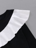 Camisa con volantes en blanco y negro para niña