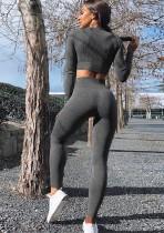 Top corto de yoga de manga larga de color liso y leggings de cintura alta