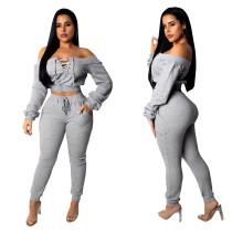 Top corto y pantalones con cordones en color liso