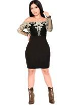 Vestido de fiesta negro con apliques fuera del hombro