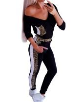 Conjunto de camisa y pantalón negro con cuello en v estampado