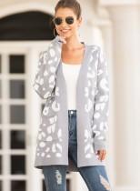 Abrigo largo con estampado de lunares y bolsillos