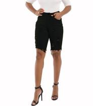 Pantalones cortos de jeans rasgados de cintura alta hasta la rodilla