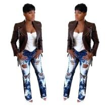 Jeans de moda blancos y azules dañados
