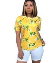 Chemise imprimée jaune à manches courtes et à col rond