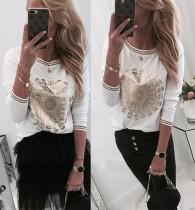 Camisa con cuello redondo estampada en blanco y dorado