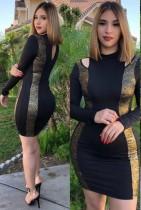 Schwarz und Gold ausgeschnittenes langärmeliges Minikleid