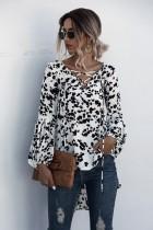 Blusa alta y baja con estampado de leopardo y mangas pop