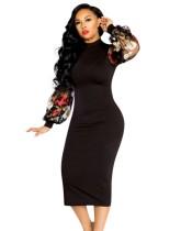 Schwarzes Midi-Kleid mit floralen Mesh-Pop-Ärmeln
