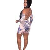 Top corto y falda cruzada con estampado de cocoteros
