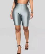 Sexy, enge, hoch taillierte Neon-Shorts