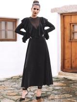 Vestido largo negro con volantes vintage con mangas