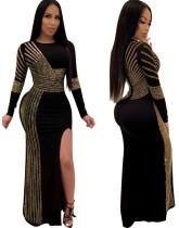 Vestido de noche de lentejuelas con aberturas en negro y dorado con mangas