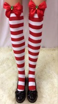 Striped Stockings With Black Bows and Christmas Tree