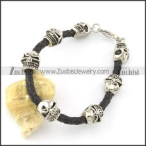 mens black leather bracelet with 7 stanless steel solid skull heads b001798