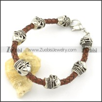 brown braided leather bracelets for men with 7 ugly skull heads b001799