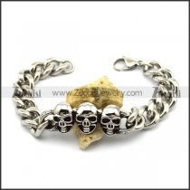 1.3cm Wide Chain Bracelet with 3 Skull Heads b003572